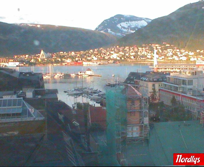 Webcam view from Nordlys newspaper over small boat port,Tromsoysund and Arctic Cathedral